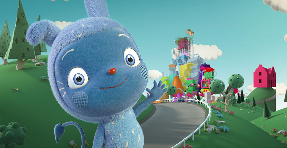 A close-up of a little blue monster waving and smiling. There is a road and a green hill behind him and a town further in the distance.