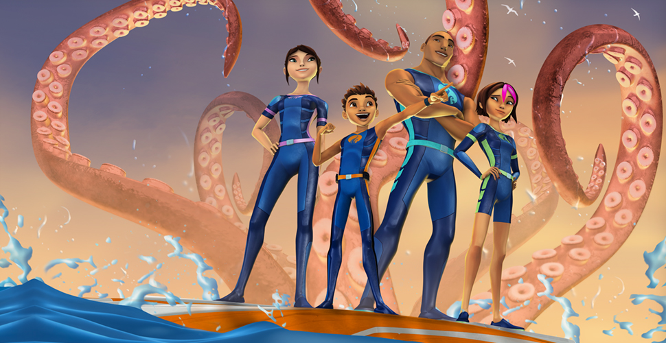 An adult man, woman, boy and a girl are standing on a platform in the middle of an ocean. They are wearing blue wetsuits and are surrounded by large, orange octopus legs.