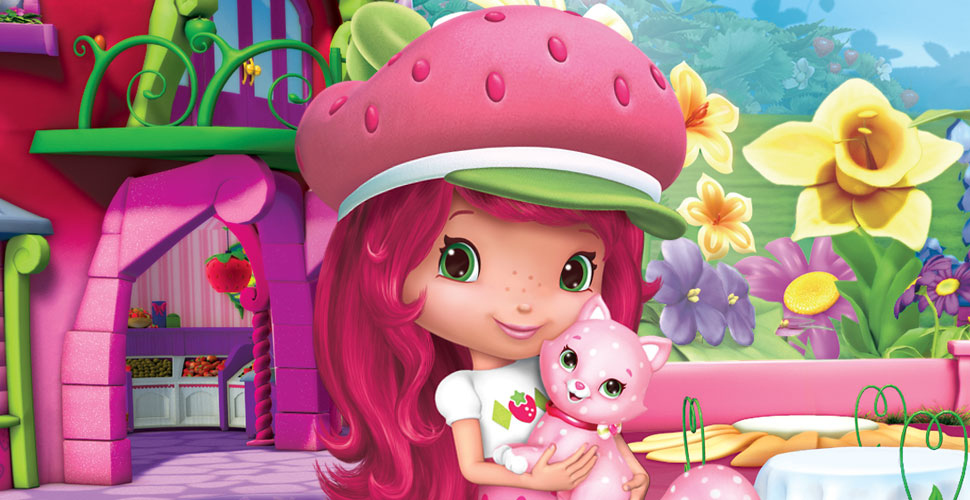 A close-up of a girl with long pink hair and a pink hat. She is standing in front of a pink house and a garden full of flowers and holding her pink cat.