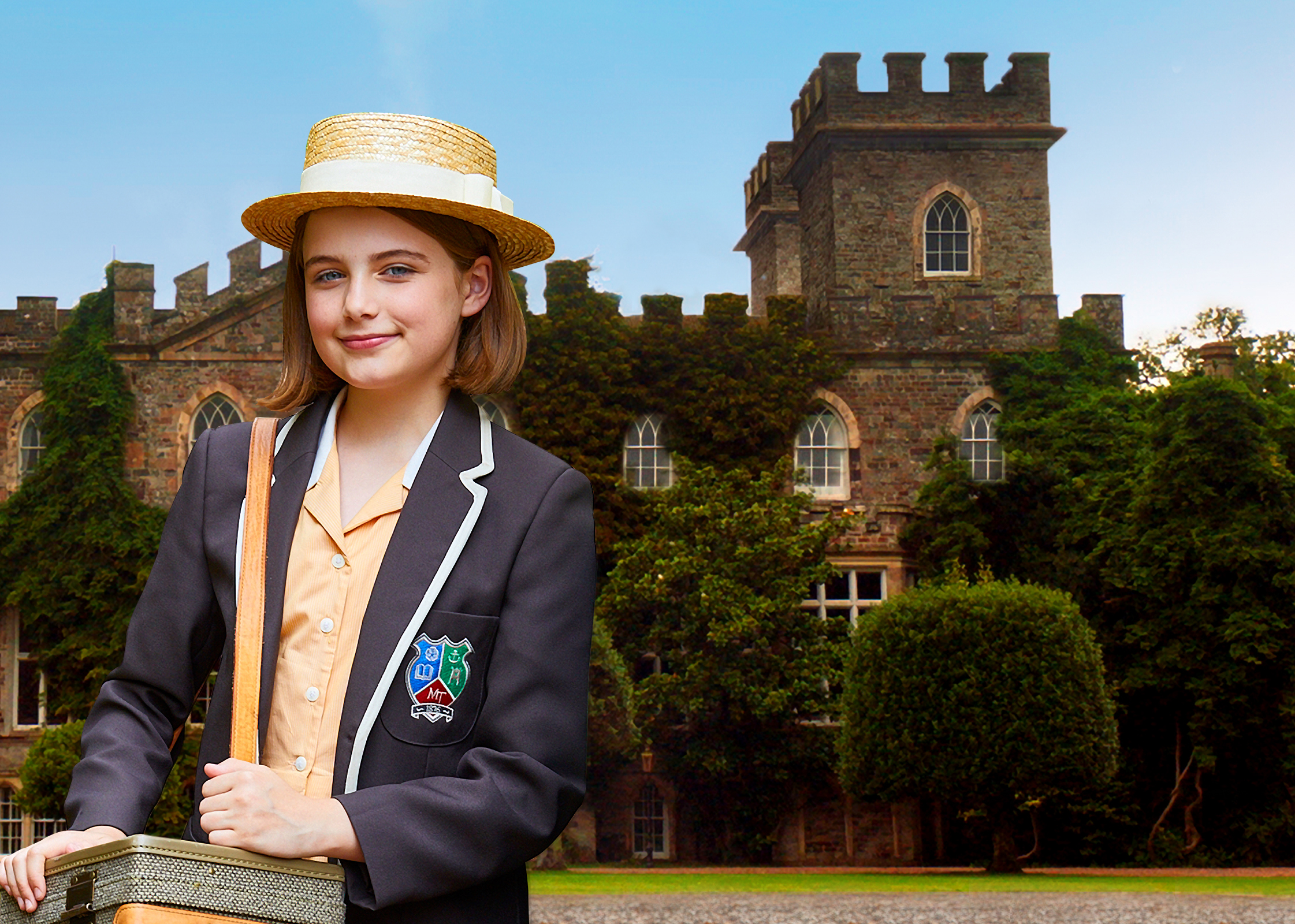 A young girl wearing a school uniform and straw hat standing in front of a boarding school surrounded by trees.